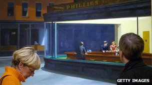 Gallery-goers looking at Edward Hopper's Nighthawks