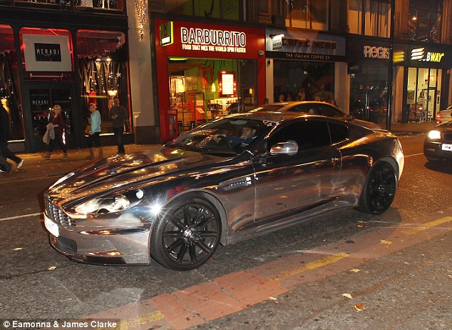 Won't be hard to see you coming! Jermaine Pennant is snapped driving about in his blinged-up, chrome wrapped Aston Martin