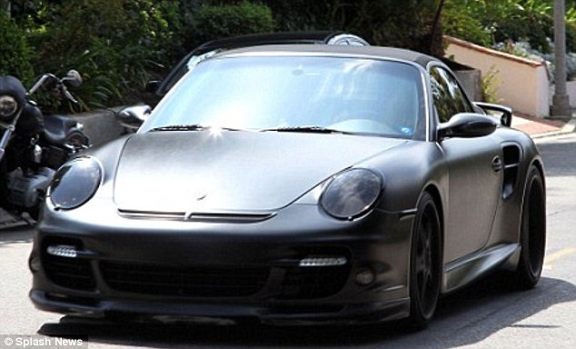 Buffed and ready: David Beckham has his Porsche vinyl wrapped in matt black
